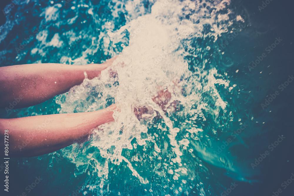 Fototapety, obrazy: Female legs splashing sea water