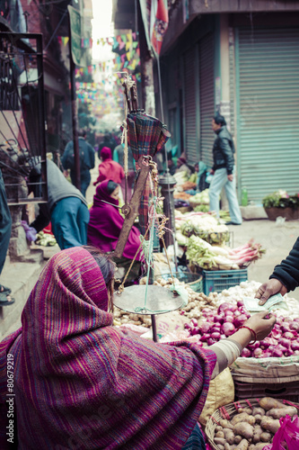Fotografie, Obraz  The street vendor sels his fruits and vegetables in Thamel in Ka