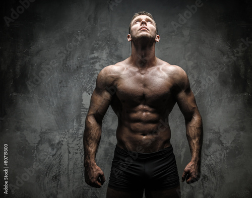 Strong muscular male in studio Wall mural