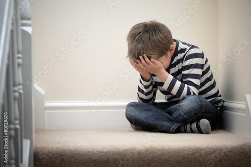 Fotografie, Tablou Upset problem child sitting on staircase