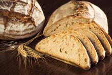 Rustic Bread And Wheat On A Da...