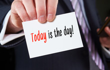A Businessman Holding A Business Card With The Words,  Today Is