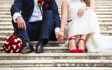 Unrecognizable Young Wedding Couple Holding Hands