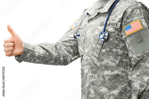 Fotografia, Obraz US Army doctor showing thumb up - studio shot