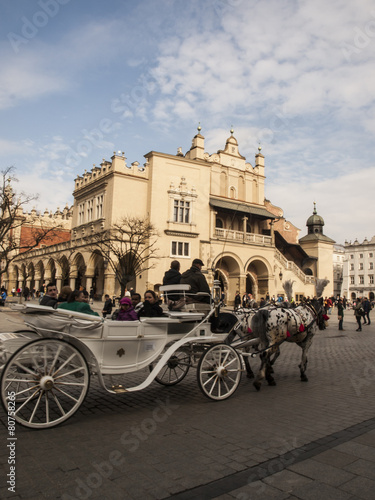 Fototapety, obrazy: KRAKOW, POLAND - March 29, 2015: Horse carriage on the streets o