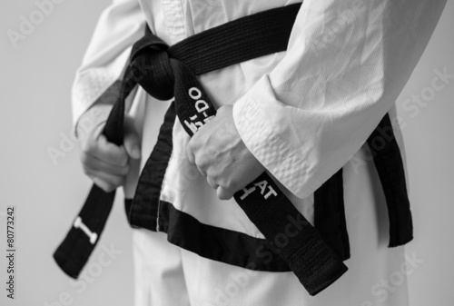 Tuinposter Vechtsport Taekwondo woman with her black belt.