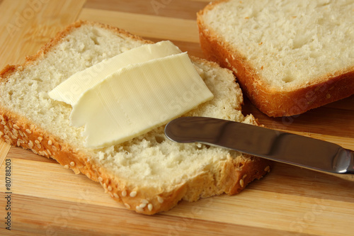 Staande foto Zuivelproducten Sandwich with butter and knife.