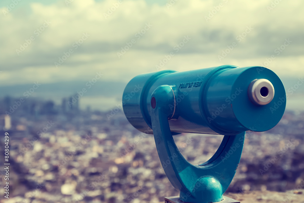Fototapety, obrazy: Blue telescope and blurred city on background.