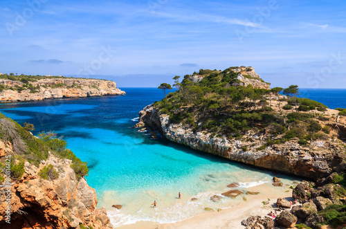 Fotografie, Obraz  Couple of people on Cala des Moro beach, Majorca island, Spain