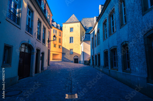 Street in Luxembourg. Sunset rays on an old building. #80827679