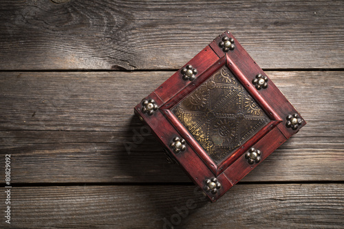 Old vintage box on wooden background Poster