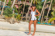 young healthy girl, woman, in sport clothes walking by tropical