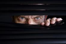 Man Spying On Something Throug...