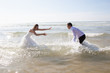 bride and groom in beach Happy just married young couple celebrating and have fun