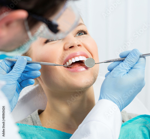Fototapety, obrazy: Dental health. Male hygienist examining patient teeth on caries