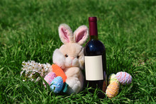 Row Of Easter Eggs Red Wine Bottle Rabbit In Grass