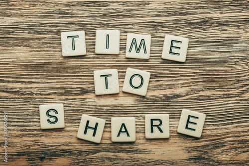 Fotografie, Obraz  Share. Time to Share text on a wooden background