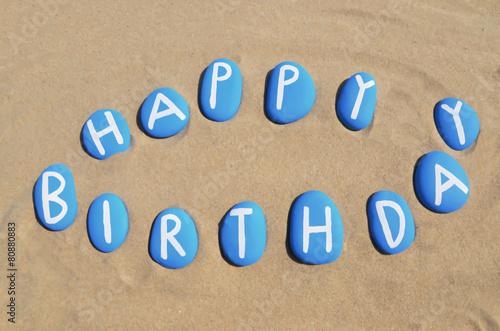 Happy Birthday on blue stones over the sand Canvas Print
