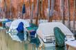 Leinwandbild Motiv Boats with tarpaulin in romantic narrow canal in Venice.