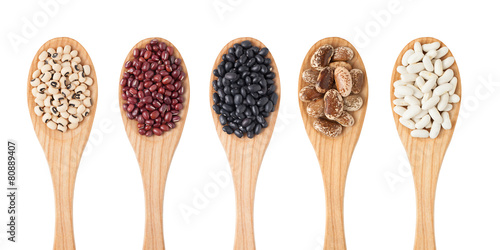 Different sorts of beans on wooden spoon Canvas-taulu