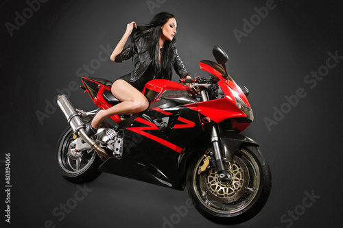 sexy young woman on motorbike