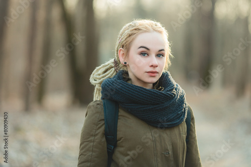 Young blonde hipster woman dreadlocks hairstyle cold season Wallpaper Mural