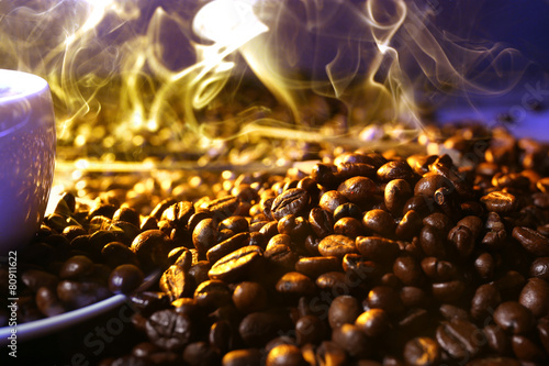 Printed kitchen splashbacks Beer / Cider Pile of coffee beans and cup of hot coffee in beam