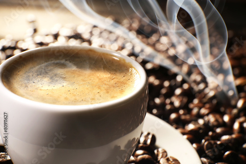 Wall Murals Cafe Cup of coffee with grains, closeup
