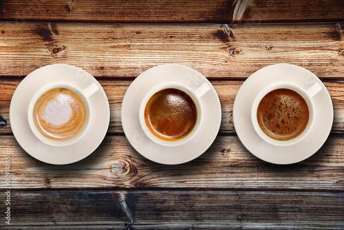 tris di caffè su fondo legno #80914865