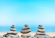 Stone pyramids on beach.