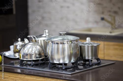 Foto op Aluminium Milkshake kettle, stainless steel pan on gas cooker top view