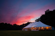 canvas print picture - An event tent at night with a sunset during a wedding