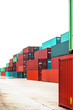 numerous shipping containers isolated on white