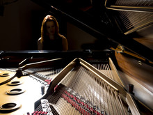 Pianist Performing On A Grand ...