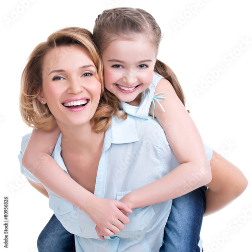 Fotografie, Obraz  Closeup portrait of happy mother and young daughter