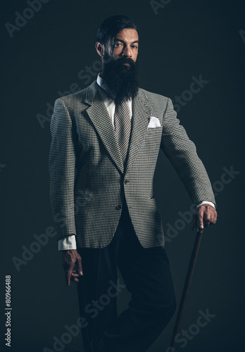 Photo  Man with Long Beard Wearing Formal Suit with Cane
