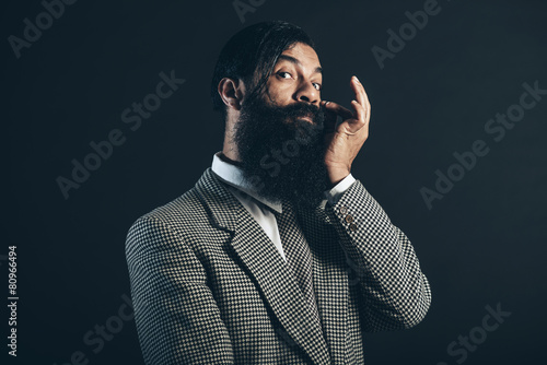 Photo  Formal Man Touching his Face and Looking at Camera