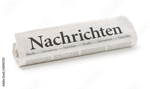 Photo  Zeitungsrolle mit der Überschrift Nachrichten