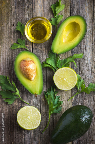 food background with fresh organic avocado, lime, parsley and ol Wallpaper Mural