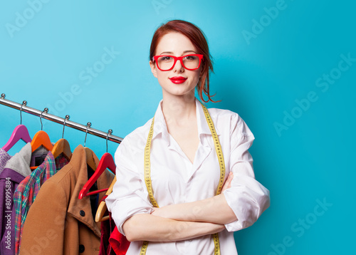 Fotografia, Obraz  Young redhead designer with metric and clothes