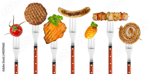 Aluminium Prints Grill / Barbecue grilled meat on forks