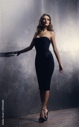 Photo  Young and gorgeous actress over a metal wall