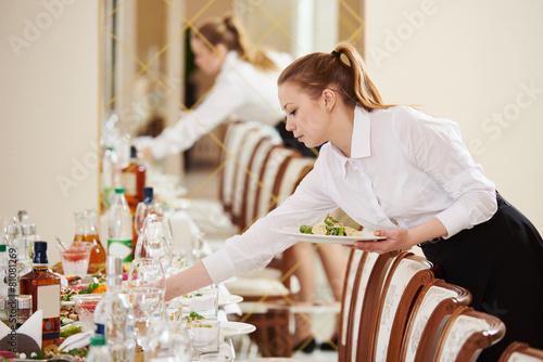 Fotobehang Restaurant waitress at catering work in a restaurant