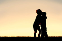 Silhouette Of Two Young Childr...