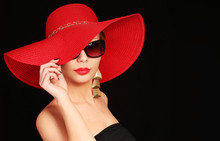 Woman In Red Hat And Sunglasse...