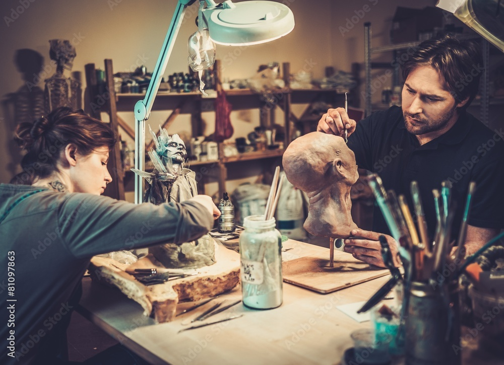 Fototapety, obrazy: People working in a prosthetic special fx workshop