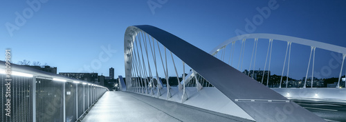 Foto op Canvas Bruggen Panoramic view of Schuman bridge by night
