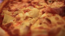 Cutting Italian Pizza With Mushrooms, Ham And Cheese. Two