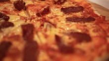 Cutting Italian Pizza With Mushrooms, Salami And Cheese. Close