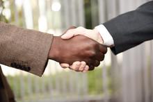 Black Businessman Shaking Hand...